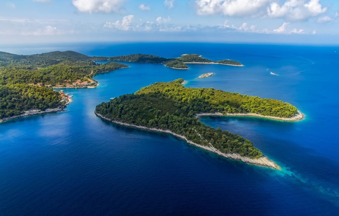 'Aerial helicopter shoot of National park on island Mljet, village Pomena, Dubrovnik archipelago, Croatia. The oldest pine forest in Europe preserved.' - Dubrovník
