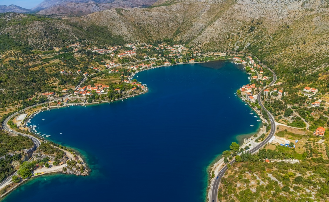 'Helicopter aerial shot of beautiful lagoon Zaton near Dubrovnik in Croatia.  Well known tourist destination.' - Dubrovník